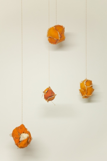 Four Sewn Oranges