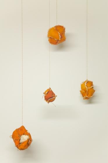 Four Sewn Oranges
